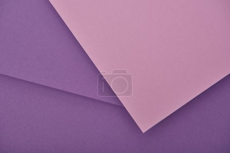 top view of lilac and violet laid out paper sheets with copy space