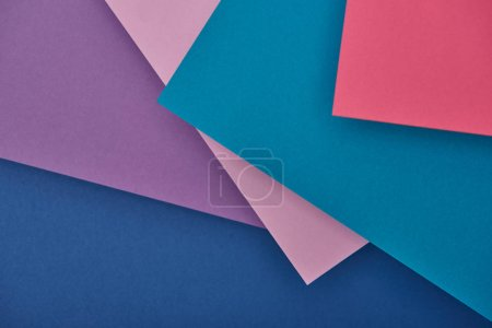 Photo for Top view of purple, blue and pink paper sheets with copy space - Royalty Free Image