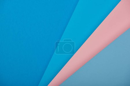 top view of blue and pink paper sheets with copy space
