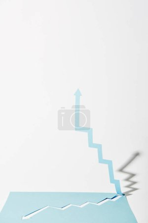 Photo for Paper upward arrow from blue paper sheet on white background - Royalty Free Image