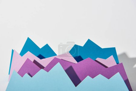 blue and purple paper graphs with copy space on white background