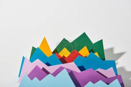 Foto de Gráficos de papel multicolor con espacio de copia sobre fondo blanco - Imagen libre de derechos