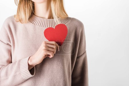 Photo for Cropped view of woman in beige sweater holding paper heart - Royalty Free Image