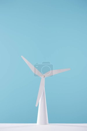 white windmill model on table and blue background
