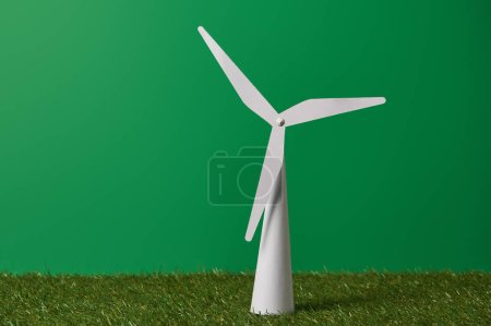 white windmill model on green grass and background