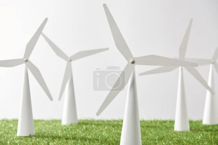 windmill models on green grass and white background