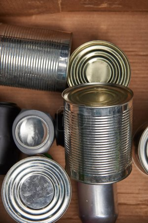 Photo for Different iron silver cans in cardboard box - Royalty Free Image