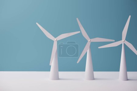windmill models on white table and blue background