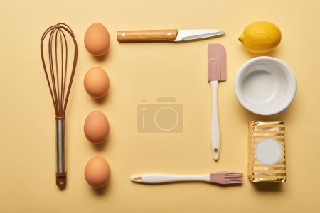 Photo for Flat lay with cooking utensils, lemon, butter and eggs on yellow background - Royalty Free Image
