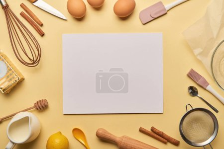 Photo for Top view of bakery ingredients and cooking utensils around blank card - Royalty Free Image