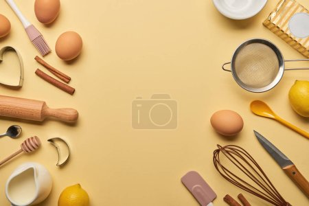 Photo for Top view of bakery ingredients and kitchenware on yellow background - Royalty Free Image