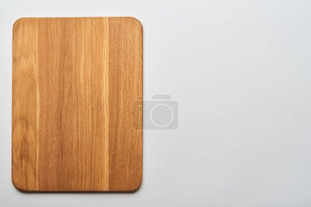 Photo for Top view of empty wooden chopping board on grey background - Royalty Free Image