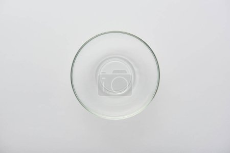 Photo for Top view of transparent glass bowl on grey background - Royalty Free Image