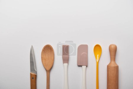 Photo for Top view of cooking utensils on grey background with copy space - Royalty Free Image
