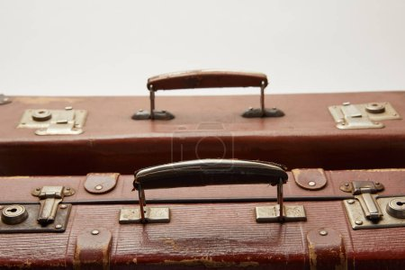 vintage brown suitcases isolated on grey