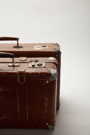brown suitcases with copy space on grey background