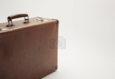 Photo for Vintage brown suitcase on grey background with copy space - Royalty Free Image