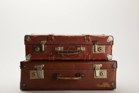 Photo for Vintage brown suitcases on grey background with copy space - Royalty Free Image