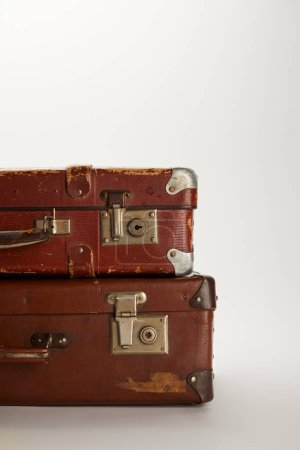 Photo for Retro brown suitcases on grey background with copy space - Royalty Free Image