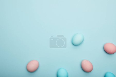 Photo for Top view of easter eggs on blue background - Royalty Free Image