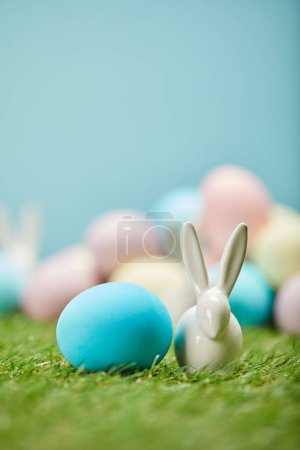 Photo for Selective focus of painted easter eggs and toy rabbit on grass with copy space - Royalty Free Image