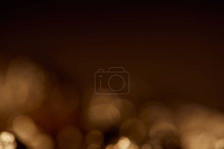Photo for Dark black background with golden sparkling lights - Royalty Free Image