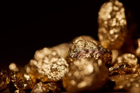 Photo for Golden blurred stones isolated on black - Royalty Free Image