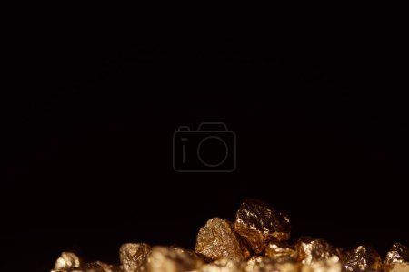 Photo for Golden stones with blurred foreground isolated on black - Royalty Free Image