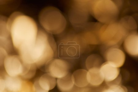 Photo for Golden sparkling lights on dark black background - Royalty Free Image