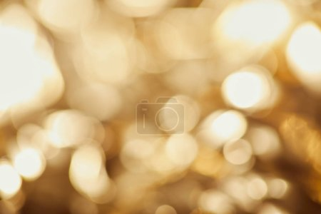 Photo for Bright sparkling lights on golden background - Royalty Free Image