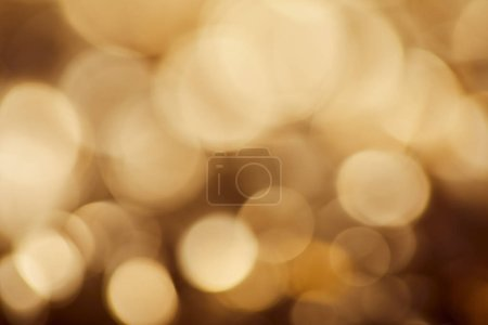 Photo for Bright brown background with golden sparkling lights - Royalty Free Image