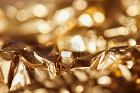 Photo for Selrctive focus of golden foil with bright sparkling lights - Royalty Free Image