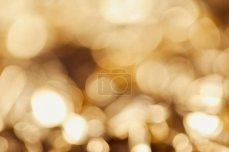 Photo for Bright blurred twinkles with golden sparkling lights - Royalty Free Image