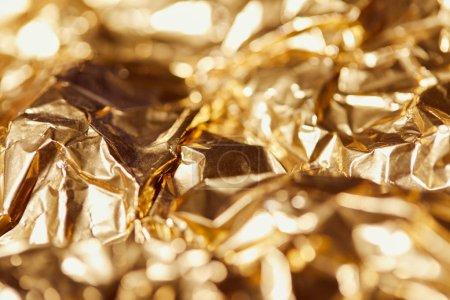 foyer sélectif de papier d'aluminium avec des lumières étincelantes dorées