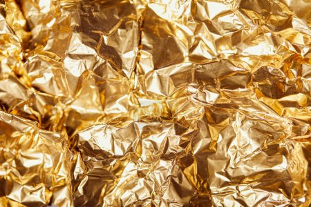 crumpled golden foil sheet with bright twinkles