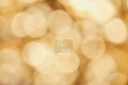 bright sparkles on blurred golden background