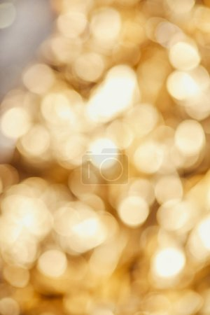 bright blurred golden twinkles and sparkles on grey background
