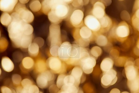 bright blurred golden twinkles and sparkles on dark background