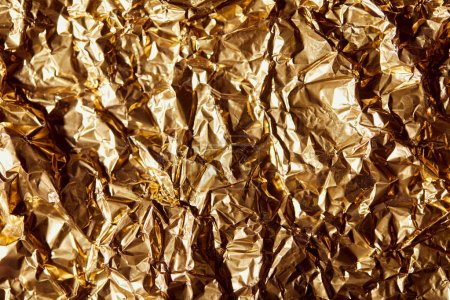 Photo for Creased golden foil sheet with twinkles - Royalty Free Image