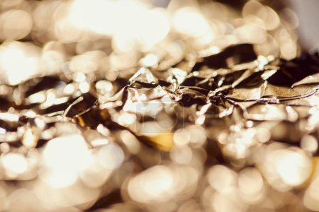 Photo for Selrctive focus of foil with sparkling lights and twinkles - Royalty Free Image