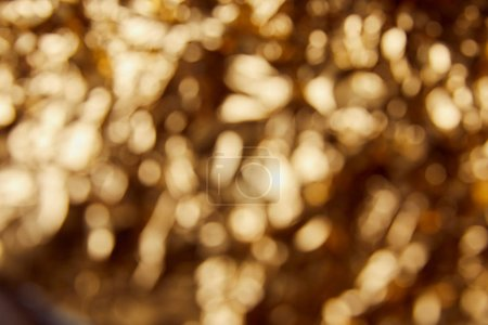 Photo pour Golden background with blurred bright twinkles and sparkles - image libre de droit