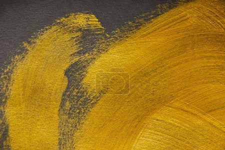 Photo for Golden brushstrokes drawn on grey textured background - Royalty Free Image