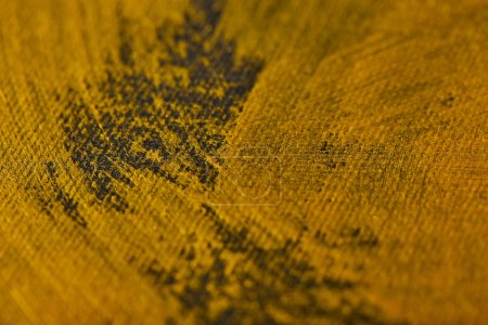 Photo for Different brushstrokes of golden paint on grey canvas - Royalty Free Image