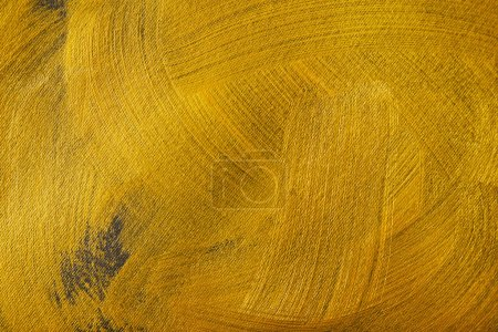 Photo for Different brushstrokes of golden paint drawn on grey canvas - Royalty Free Image