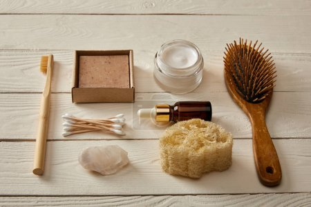 Photo pour Flat lay of hygiene and cosmetic items on white wooden surface, zero waste concept - image libre de droit