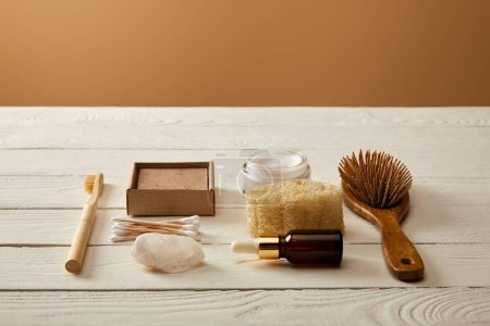 Photo for Different hygiene and cosmetic items on white wooden surface, zero waste concept - Royalty Free Image