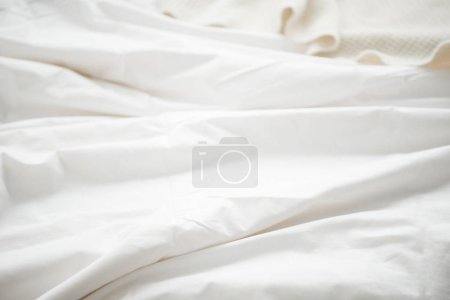 Photo for Selective focus of white blanket at bedroom - Royalty Free Image