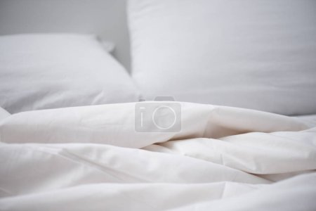 Photo for Selective focus of empty bed with white blanket and pillow - Royalty Free Image