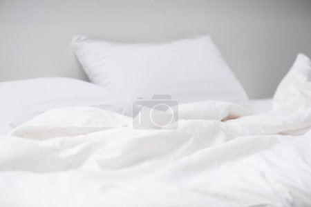 Photo for Selective focus of empty cozy bed with white pillows and blanket - Royalty Free Image