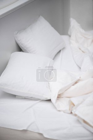 Photo for Selective focus of bedroom with white pillows and blanket on bed - Royalty Free Image